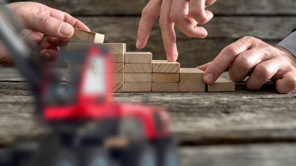 Hands playing with wooden blocks